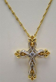 """1"""" x 1.50"""" cz cross pendant. We are a family owned fine jewelry store in Southern Indiana. We buy and sell gold, diamonds, watches, coins, currency, and fine luxury items of value."""