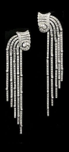 A stunning pair of Art Deco platinum and diamond earrings circa Designed as a cascading waterfall of diamonds, the tops modelled as stylised vessels with scrolled and fluted necks from which pour forth five articulated rows of round diamonds taperin Art Deco Jewelry, Fine Jewelry, Jewelry Design, Art Deco Earrings, Jewelry Accessories, Sterling Silver Jewelry, Antique Jewelry, Vintage Jewelry, Silver Rings