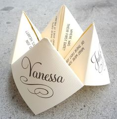 wedding cootie catcher - could be cute to put on the dinner plates or somethign