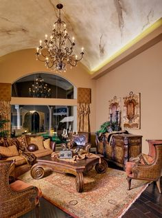 Love the huge coffee table and drapes in this room.