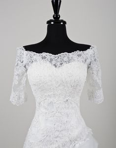 Justin Alexander wedding accessories style A072 Beaded Alencon lace off the shoulder jacket with three quarter length sleeves.