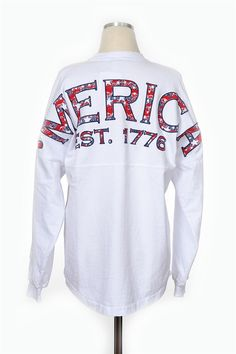 Theyre here Our Merica Spirit Jersey is perfect for every day of the year A long sleeved over sized tee with a screen printed back. How perfect will this top be with jean shorts and sunnies An additional 7 added to order for monogramming fees.