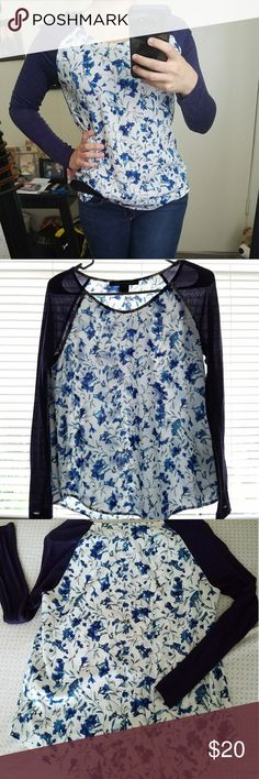Navy Blue Floral Shirt Super cute long sleeve shirt with navy blue sleeves and blue floral print on the body of the shirt! Only worn once, like-new condition. The sleeves are a soft material while the body of the shirt has more of a chiffon feel to it. Looks cute with leggings or jeans! Could also be super cute with some white shorts! The body of the shirt is a tad see-through as shown in the picture in front of the window but it isn't major, just wear a nude or white bra! Or even a tank…