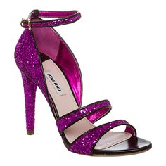 Turn some heads in these glitzy leather sandals from Miu Miu featuring glittery purple straps and a tall stiletto heel. These leggy pumps are made with a slightly cushioned footbed and finished with an adjustable ankle strap to secure your foot.