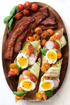 Kicking off the weekend with ciabatta toasts. Smothered in hummus, topped with cucumbers, tomatoes, radishes, jammy eggs, chilies & basil. Served with thick cut maple glazed bacon! 🥓 Happy Saturday my friends! Egg Toast, Maple Glaze, Ciabatta, Hummus, Cobb Salad, Basil, Chili, Sausage, Brunch