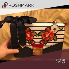 Aldo bag with flower and bow in navy Nice condition in 98% new. Famous 06c8ab82ff3