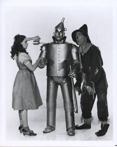 """Dorothy: How do you talk if you don't have a brain? Scarecrow: Well, some people without brains do an awful lot of talking, don't they? ~ """"The Wizard of Oz"""" Judy Garland, Science Fiction, Wizard Of Oz 1939, Dorothy Gale, Land Of Oz, Yellow Brick Road, Costume, The Wiz, Back In The Day"""