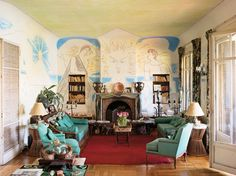 Madeleine Castaing designed this room around Jean Cocteau's painting that surrounds the fireplace. Fabulous!    More info here: http://www.nytimes.com/2010/08/22/t-magazine/22well-cocteau-t.html?_r=0