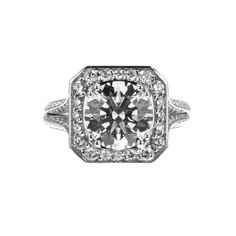 Brides.com: Engagement Rings with Large Center Stones. Style R748PD, platinum split-shank knife-edge halo diamond engagement ring with asscher-cut frame, $5,890, Mark Patterson  See more Mark Patterson engagement rings.