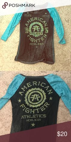 American Fighter black and blue Three quarter sleeve American Fighter shirt. Really comfortable even though worn a couple of times. Bought from Buckle. No holes or distress. American Fighter Tops Tees - Short Sleeve