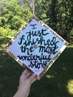 "High school graduation cap inspired by Disney's Beauty and the Beast. ""I just finished the most wonderful story"" said by Belle and ""I want adventure in the great wide somewhere"" perfect for high school and college graduations on the hats."