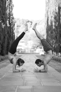 forearm stand toward scorpion.  love the composition in the alley of trees.  like that their feet aren't touching showing their own individual strength.