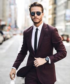 """Follow @mensdailypost  DAPPER LOOK Oxblood two piece suit, crisp white shirt, black skinny tie. Cc @iamgalla"""