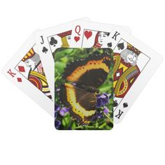 A Milbert's Tortoiseshell butterfly playing cards