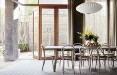 The Toorak home of Jeff and Mariko Provan. Above, open plan dining area with Thonet Bistro chairs and George Nelson Bubble Lamp. Photo – Eve Wilson, production – Lucy Feagins / The Design Files. Beautiful Dining Rooms, Beautiful Homes, Interior Architecture, Interior And Exterior, Melbourne House, Bentwood Chairs, Home Upgrades, Australian Homes, The Design Files