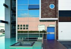 Light blue Synua modern door by Oikos Venezia with vertical sectors.