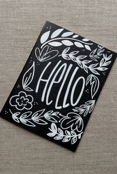 Black and white hand lettered 'Hello' by FrankyandJDesigns on Etsy