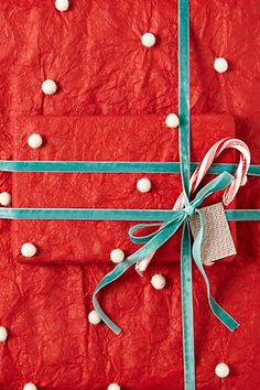 Red & Aqua:  Pom Pom Christmas Wrapping Paper from Anthropologie.  Could probably DIY this too.