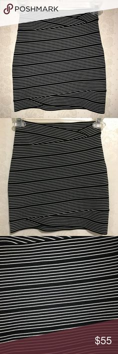 BCBG MaxAzria black/white strip skirt BCBG black/white body con skirt. very stretchy material. this skirt is truly a most have goes perfect with any style of top. very good conditions hardly worn  -No Stains, no holes, no rips, no fading. item is in great conditions.   -Color may slightly vary from photo.  -I work to provide good quality product and the best customer service. All of my items are in great conditions. i would not sale anything in a condition i would not wear. please message me…