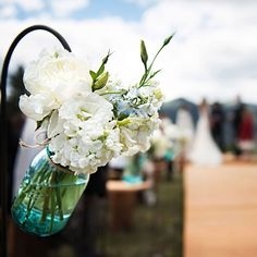 White peony and hydrangea in mason jars as wedding ceremony decor (Lauren Brown Photography)