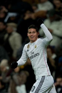 James Rodriguez Photos Photos - James Rodriguez celebrates scoring their opening goal during the La Liga match between Real Madrid CF and Sevilla FC at Estadio Santiago Bernabeu on February 4, 2015 in Madrid, Spain. - Real Madrid CF v Sevilla FC