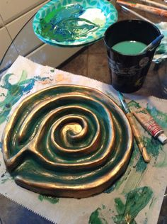 """From Tamara: made this rustic finger labyrinth from aid dry clay, acrylic paint, and wax copper rub. It's full sized so you can use your whole finger instead of a tracing stick. This is now in our """"peace corner"""" and has already been used by kids and adults alike for meditation and breathing."""