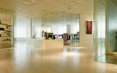We are a global and creative design studio in Geneva, Tokyo and Beijing. Showroom Interior Design, Retail Interior, Retail Experience, Glass Walls, White Chairs, Retail Space, Wood Floor, Retail Design, Creative Design