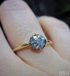 b9f8d90fe8d Fancy gray Old European cut diamond in a cut down silver collet setting  engagement ring.