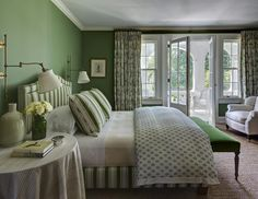 Elegant green on green master bedroom