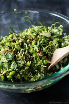 A light gluten free Autumn Kale & Shaved Brussel Sprout Salad infused with crispy bacon, edamame, and a surprise sweet fruit that compliments the dish perfectly. The ultimate side dish you need on your table this holiday season!  joyfulhealthyeats.com
