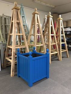 Versailles Planter with acorn finials, painted Moon Shadow (Little Greene Paint Company) + 4 x tall Large Wooden Garden Obelisks made from Accoya with 25 year timber guarantee.