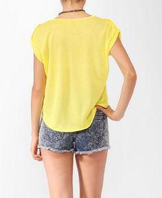 Neon Yellow button sleeve top (Forever 21, under thirteen bucks). Wear with sidearm in an inside the waistband holster behind the hip. May need an undershirt  due to sheerness of fabric.