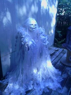 Halloween Glowing Ghost- PVC pipe. string off I/O lights and strips of plastic sheeting with a dollar store mask to complete!