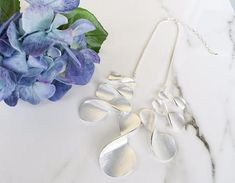 Get gorgeous with this stunning silver statement necklace. A modern, statement approach to an infinity necklace, this piece will go with everything, especially an evening dress or pantsuit.   Statement Jewellery   Statement Necklace   Women's Fashion Accessories    #affordableluxury #statement jewelry #statement necklace
