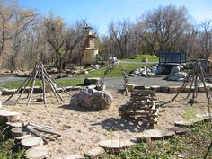 use stumps to form the edge for a play area. MANY other natural playscape ideas at this site!