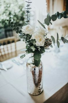Eucalyptus and white roses in a vase ❤