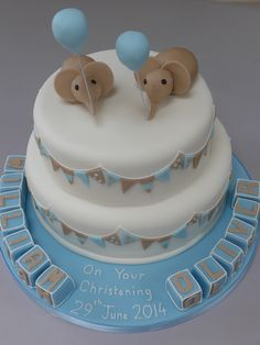 Two-tier - one chocolate, one vanilla -christening cake for two lovely boys, with fondants name blocks and elephants.