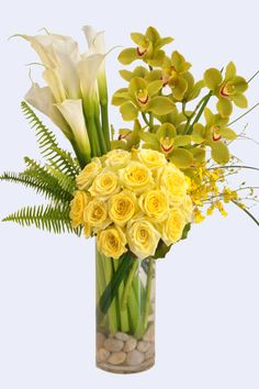 Tall cylinder filled with yellow roses, white callas, yellow oncidium orchids and lime green cymbidiums From Flowers
