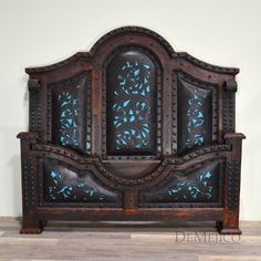 We loved creating this bed with hand-tooled leather & blue accents.