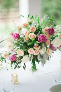 Garden Wedding - Gorgeous centerpiece! Sunkissed Blooms floral design photographed by Lyndsey A Photography at Ashley Inn in Kentucky. Wedding florals with lots of lush greenery and garden-inspired natural textures.