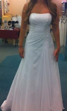 David's Bridal V9409 wedding dress currently for sale at 0% off retail.