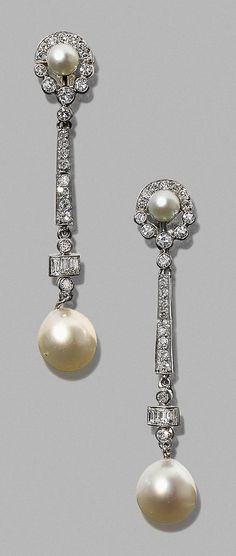 A pair of Art Deco platinum, diamond and pearl earrings, 1930s. Check out our Art Jewellery Section at Songofjewellery.com. Free shipping.