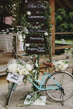 Directional signs adorned with cascading greenery pair with a vintage bike for a rustic look that borders on whimsy.