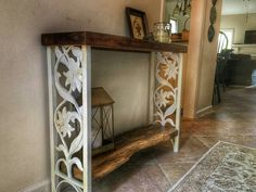 Entryway table i handcrafted using vintage wrought iron post for legs and 100+ yr old reclaimed wood!