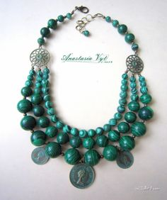 Traditional Ukrainian malachite bead necklace (namysto) decorated with coins