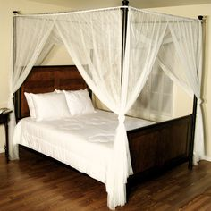 Traditional Canopy Bed Design with Wooden Floor and Cream Wall Paint Color and Awesome White Cushions and Wooden Headboard also Brilliant White Curtains Canopy Decoration