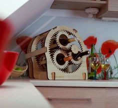 Don't drink a lot of wine to justify this, but this is just too cool! Planetary gear wine stand