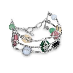 Shades of rosy pink, spring green, buttery yellow, periwinkle and black give this bracelet color and fashion forward versatility. A variety of gorgeous gemstones, including round and oval rhodonite, green quartzite, yellow jasper, blue lace agate and onyx, float on three strands of sterling silver. A sterling silver overlay or rope on each stone and beaded accents on the bracelet provide the finishing touches that make this piece a stylish stunner.