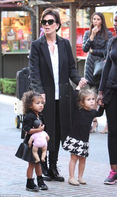 Look what she got: Perhaps North found something she liked for she was seen holding a life-sized baby doll in her arm while Penelope appeared doll-less