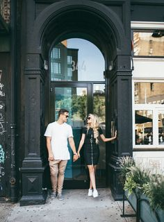 Barefoot Blonde Amber and David in Doorway in black dress